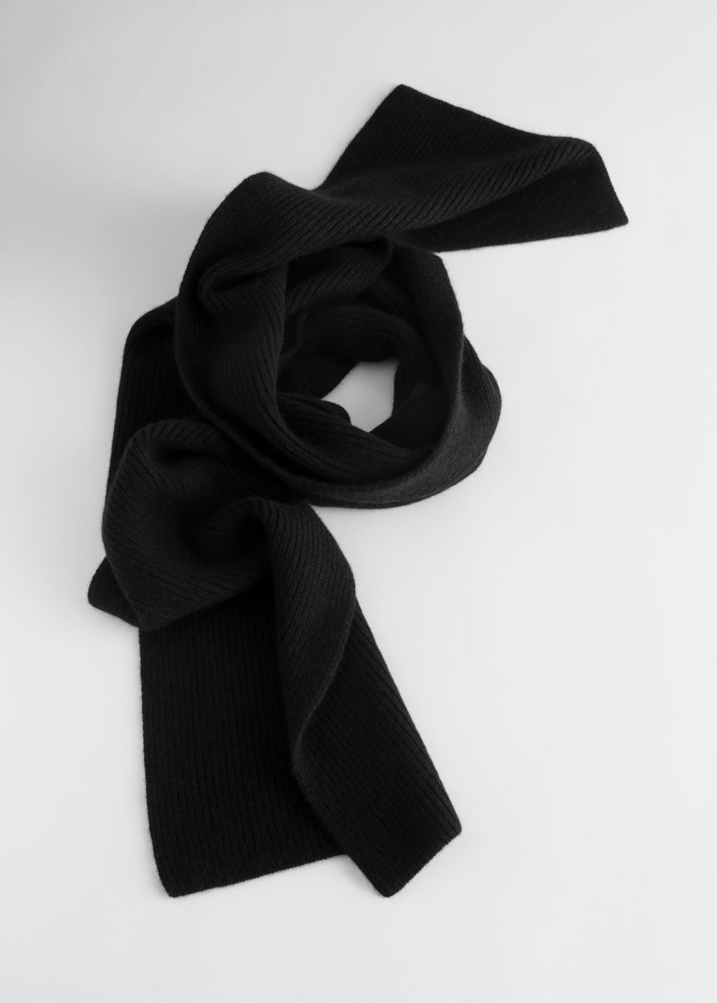 Front image of Stories ribbed cashmere scarf in black