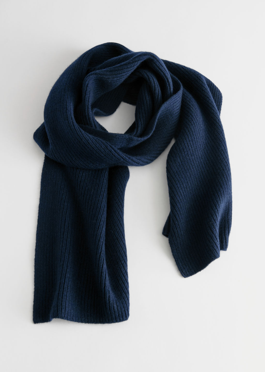 Front image of Stories ribbed knit scarf in blue