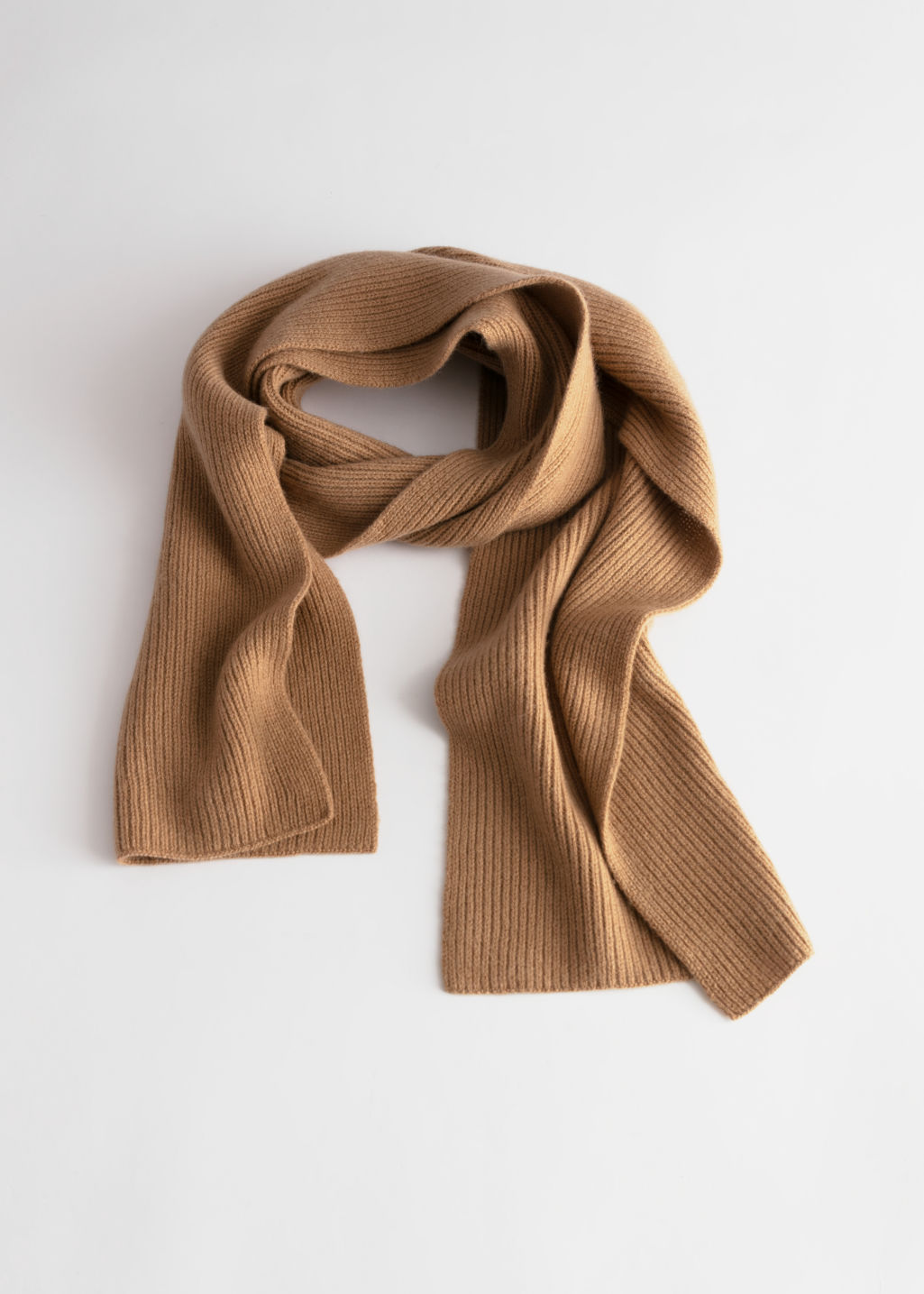 Front image of Stories ribbed knit scarf in beige
