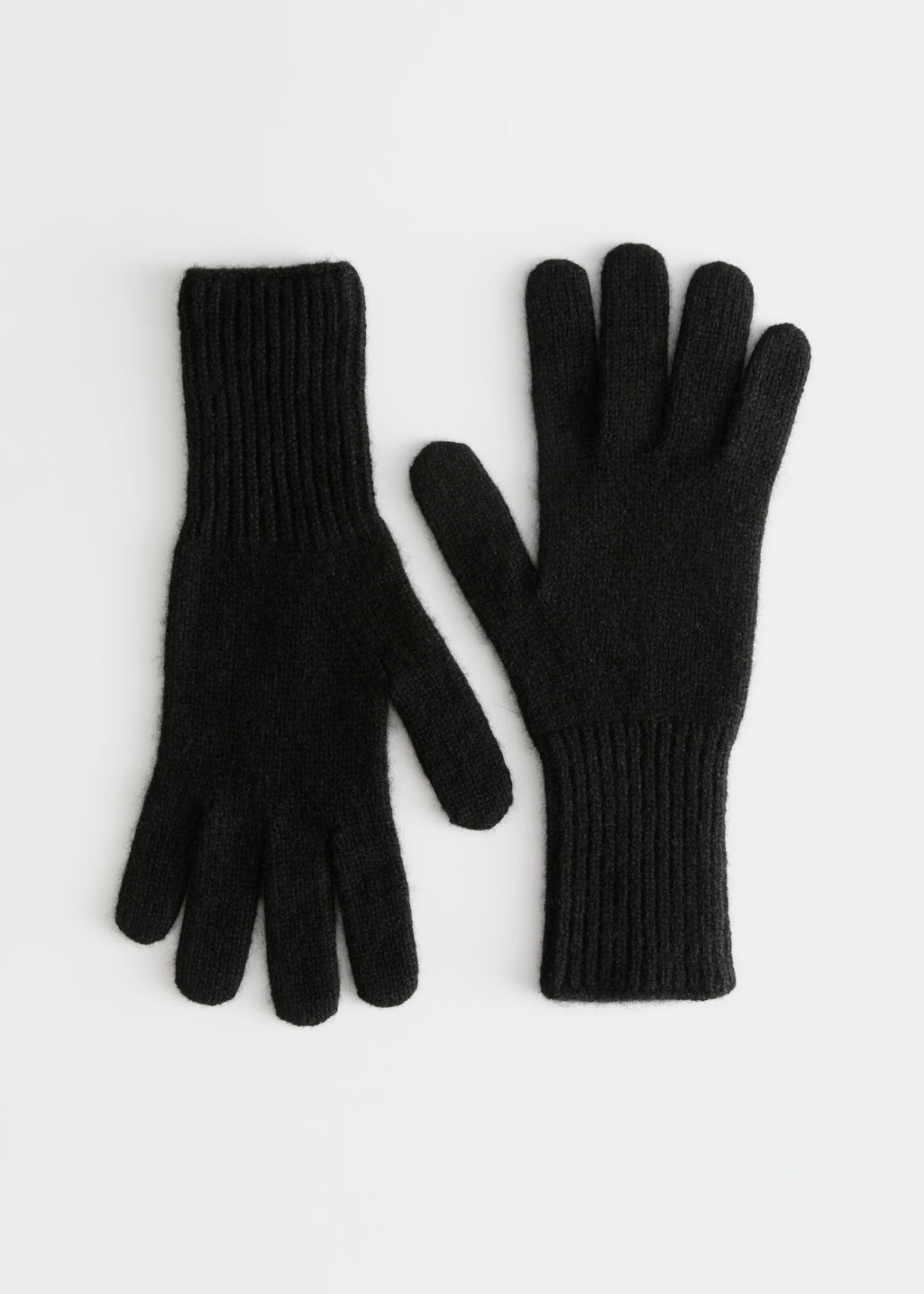 Front image of Stories cashmere gloves  in black