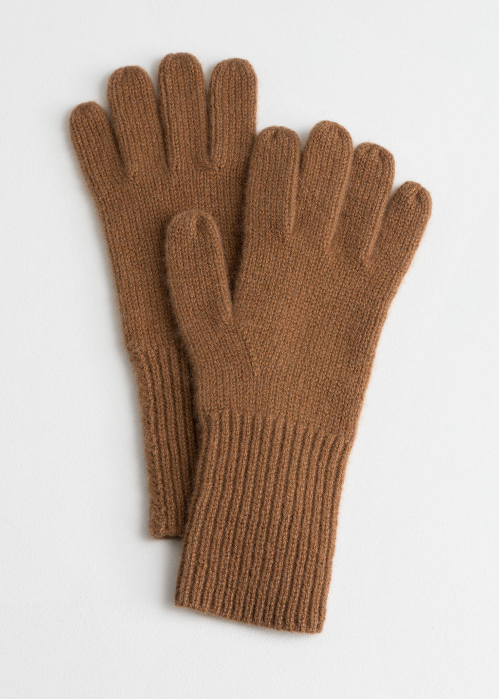 Front image of Stories cashmere gloves  in beige