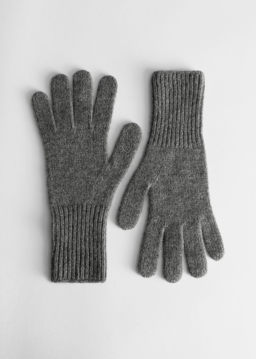 Front image of Stories soft knit gloves  in grey