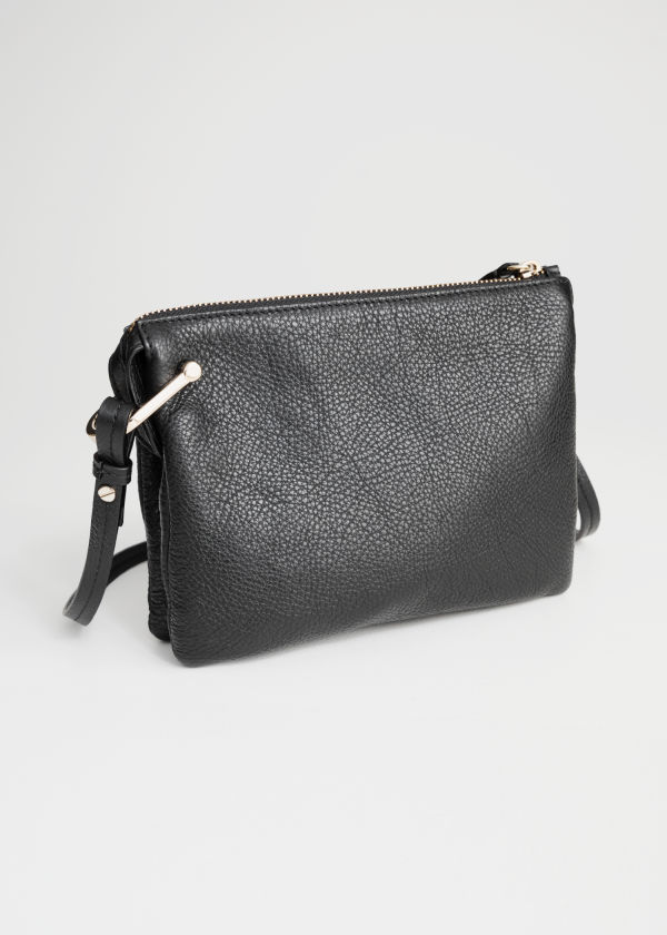 Front image of Stories d-ring crossbody bag in black