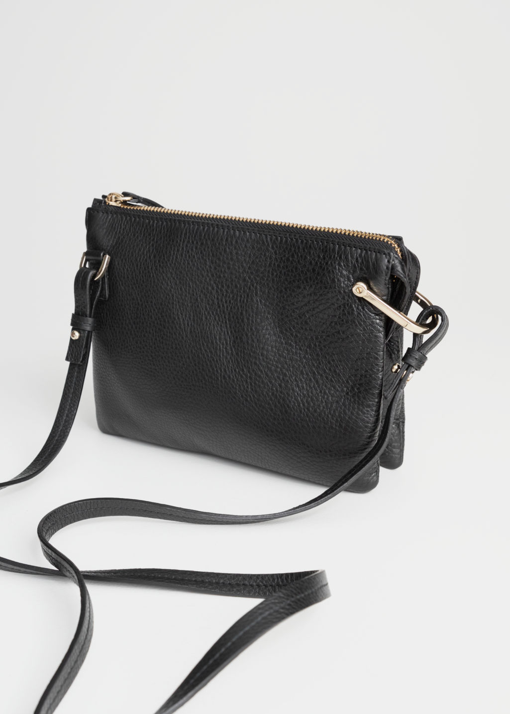 Back image of Stories d-ring crossbody bag in black