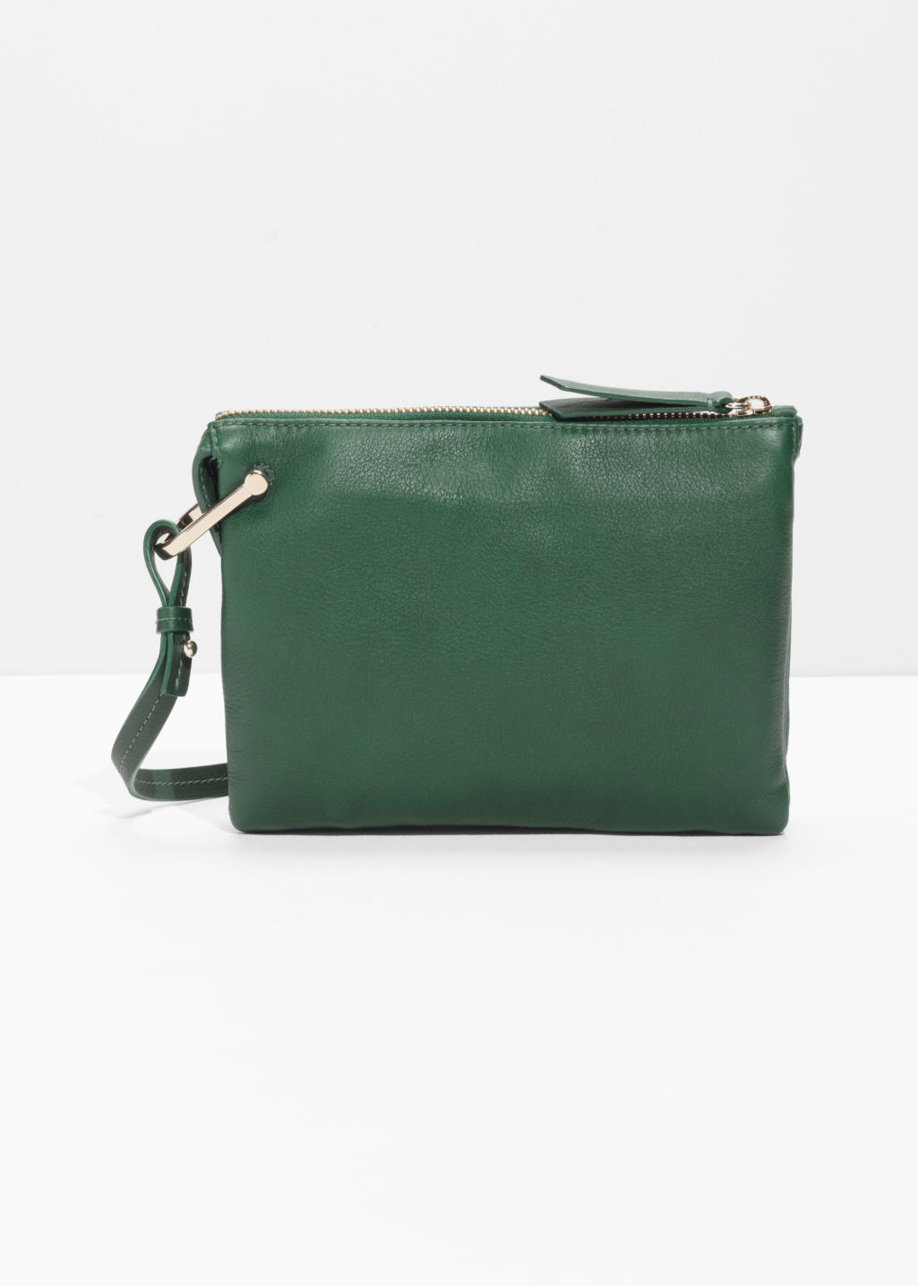Front image of Stories d-ring crossbody bag in green