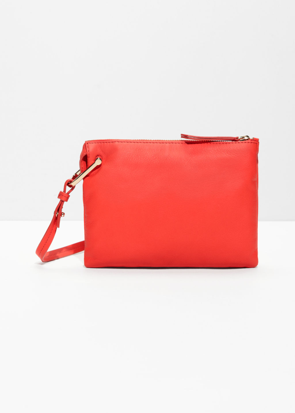 Front image of Stories d-ring crossbody bag in orange