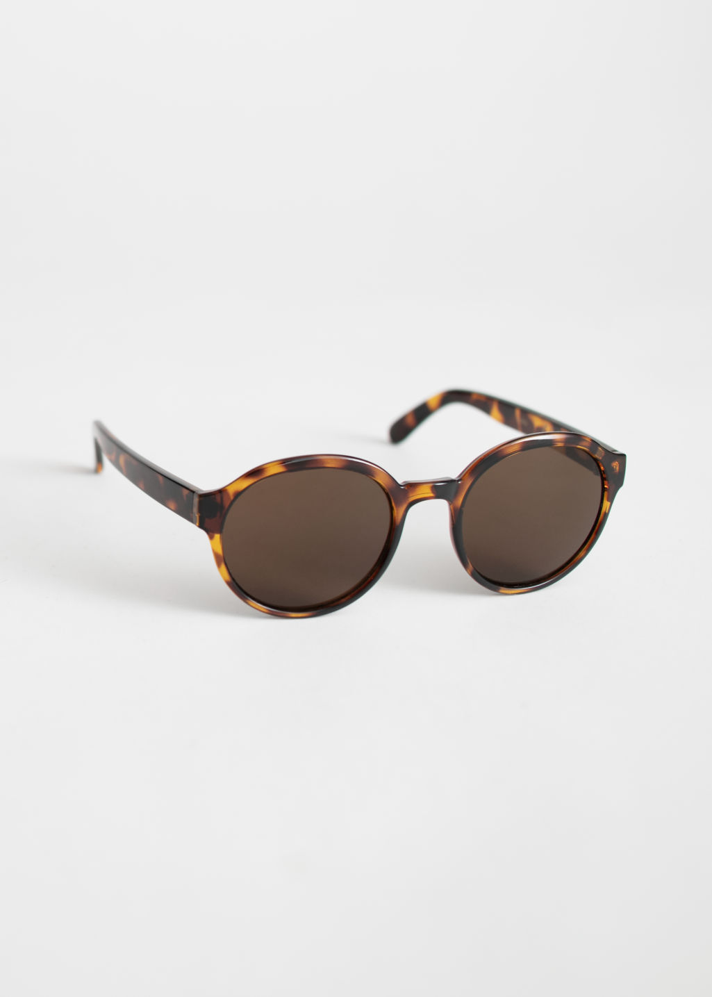 Front image of Stories round frame sunglasses in beige
