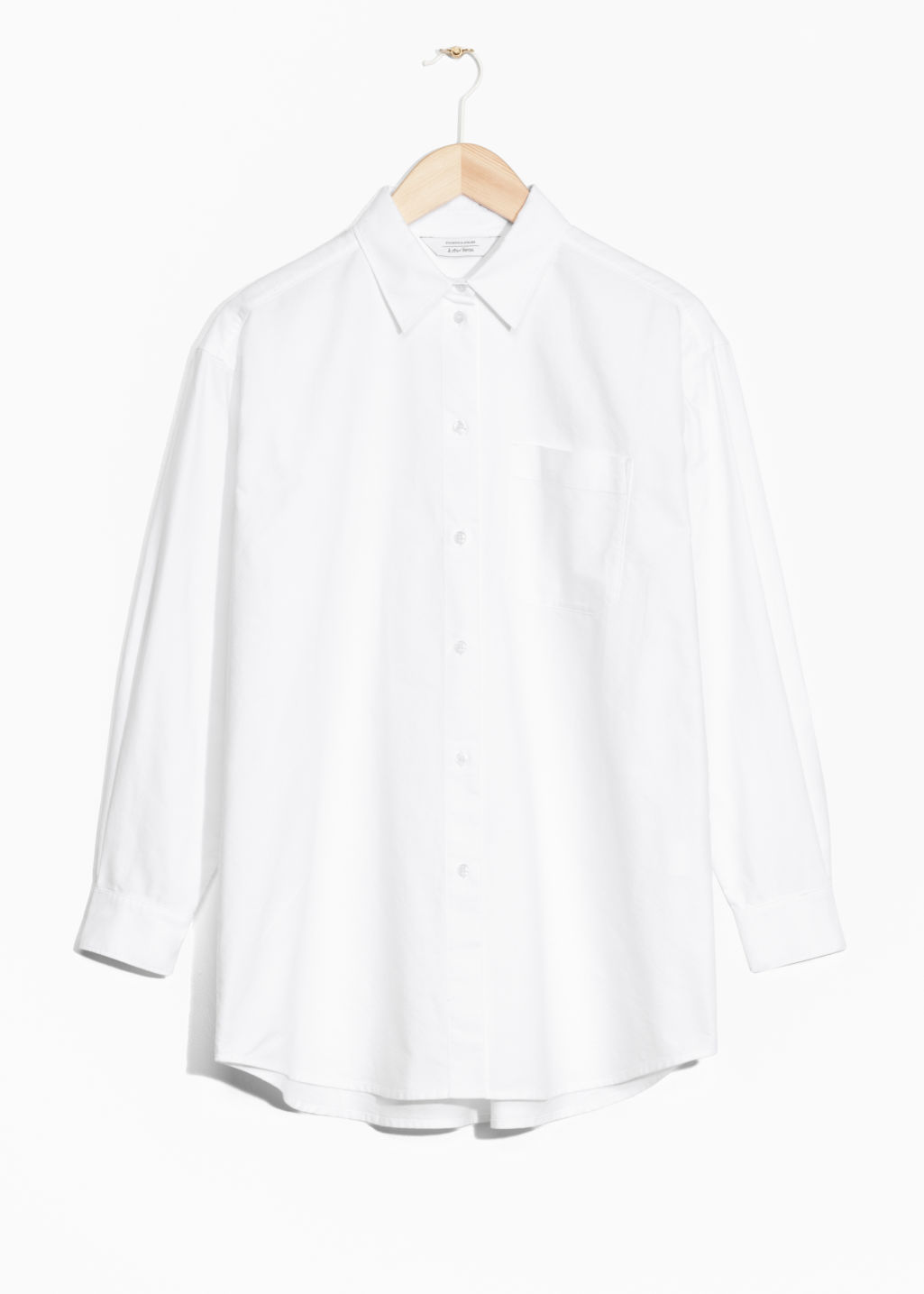 Front image of Stories oversized shirt in white