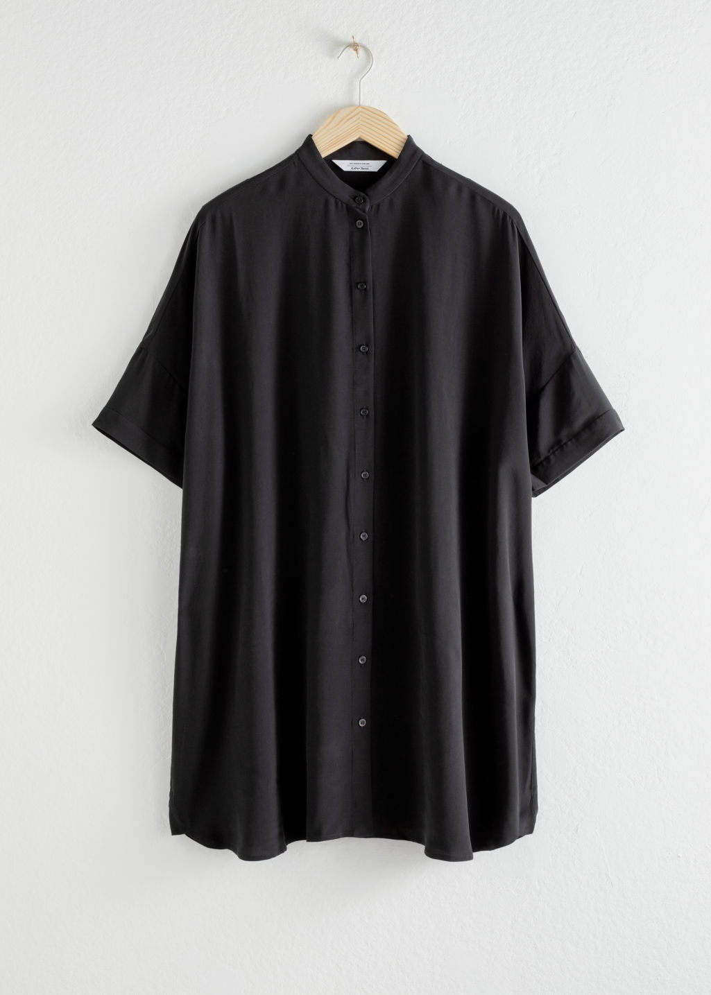 Front image of Stories oversized shirt dress in black