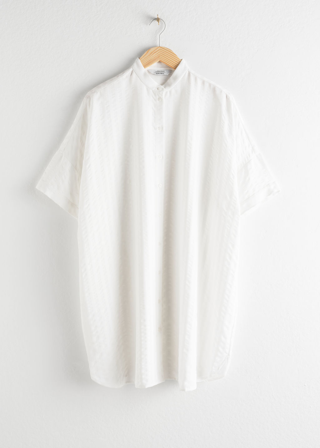 Front image of Stories oversized shirt dress in white