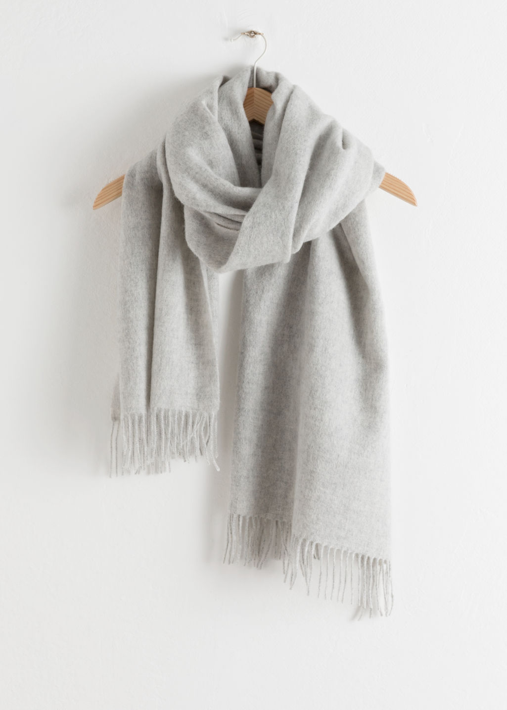 Front image of Stories oversized wool scarf in white