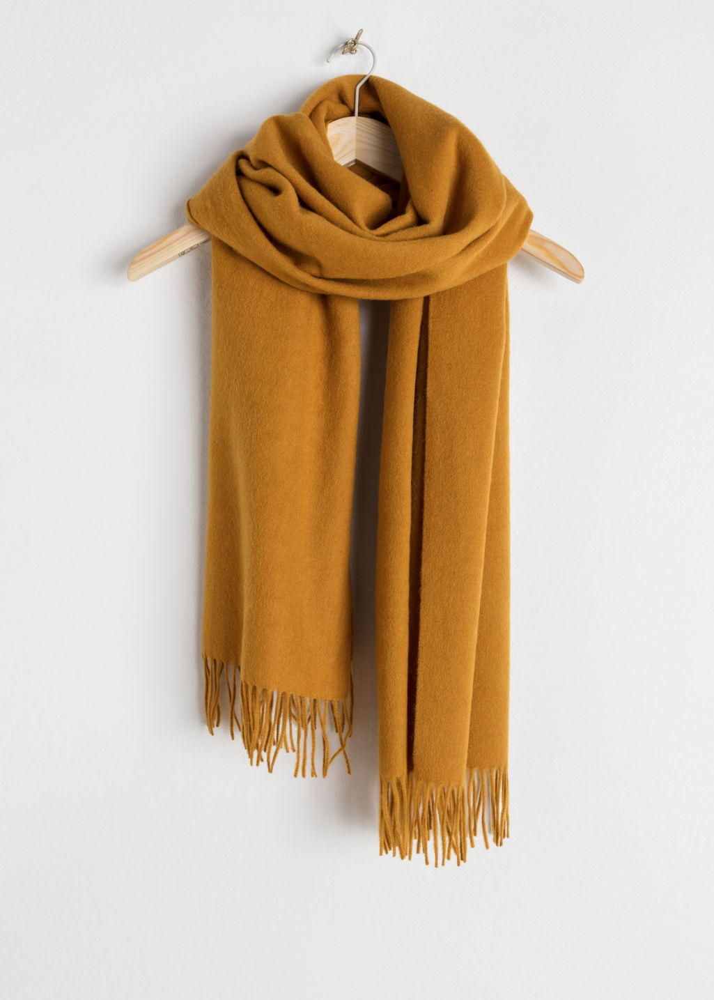 Front image of Stories oversized wool scarf in yellow