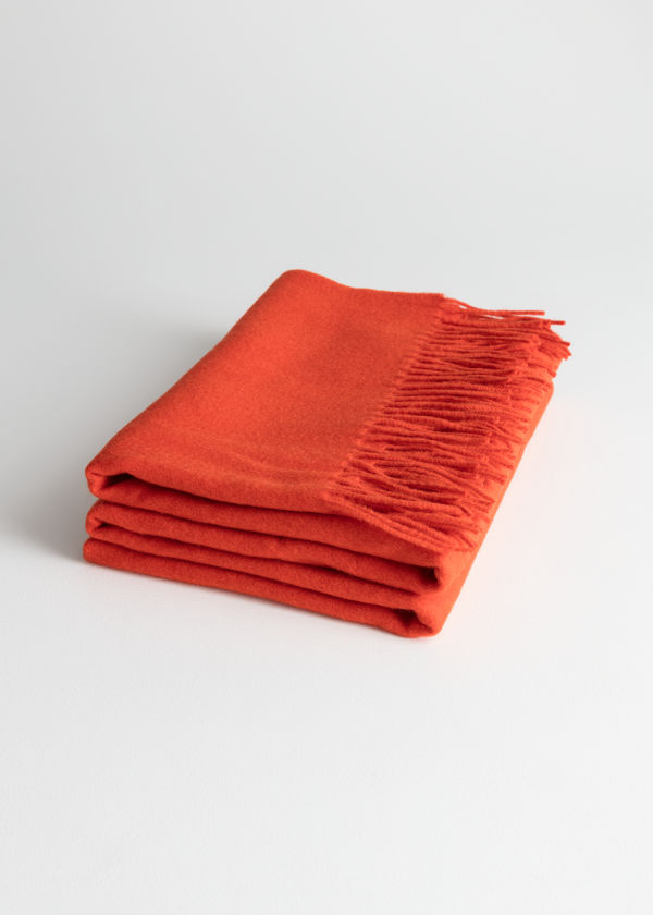 Front image of Stories oversized wool scarf in orange