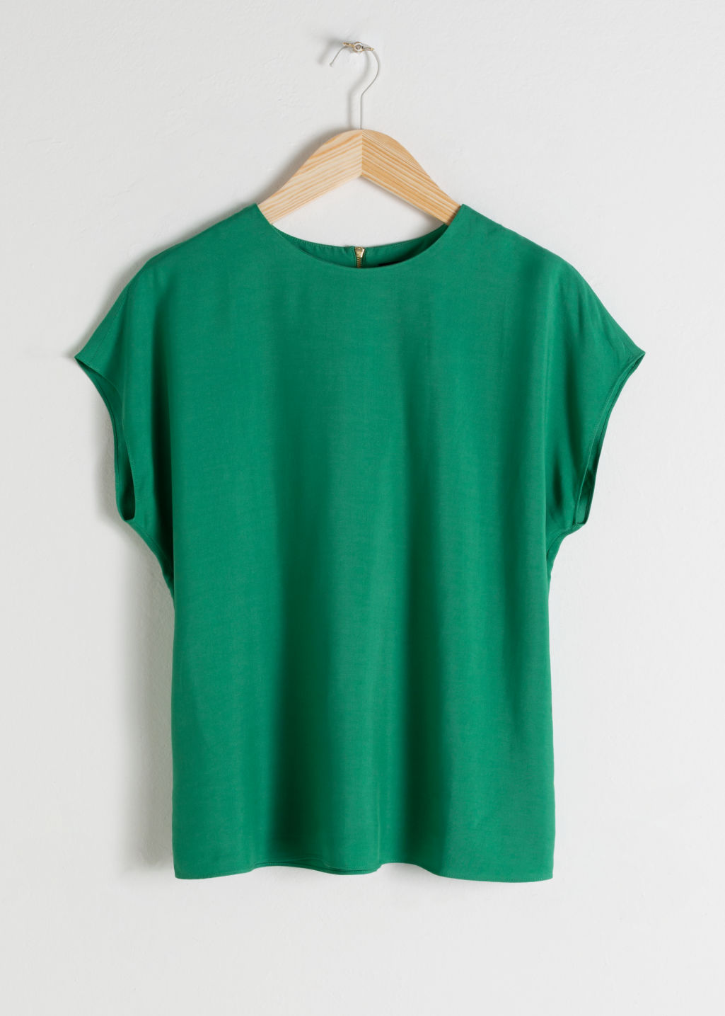Front image of Stories viscose top in green