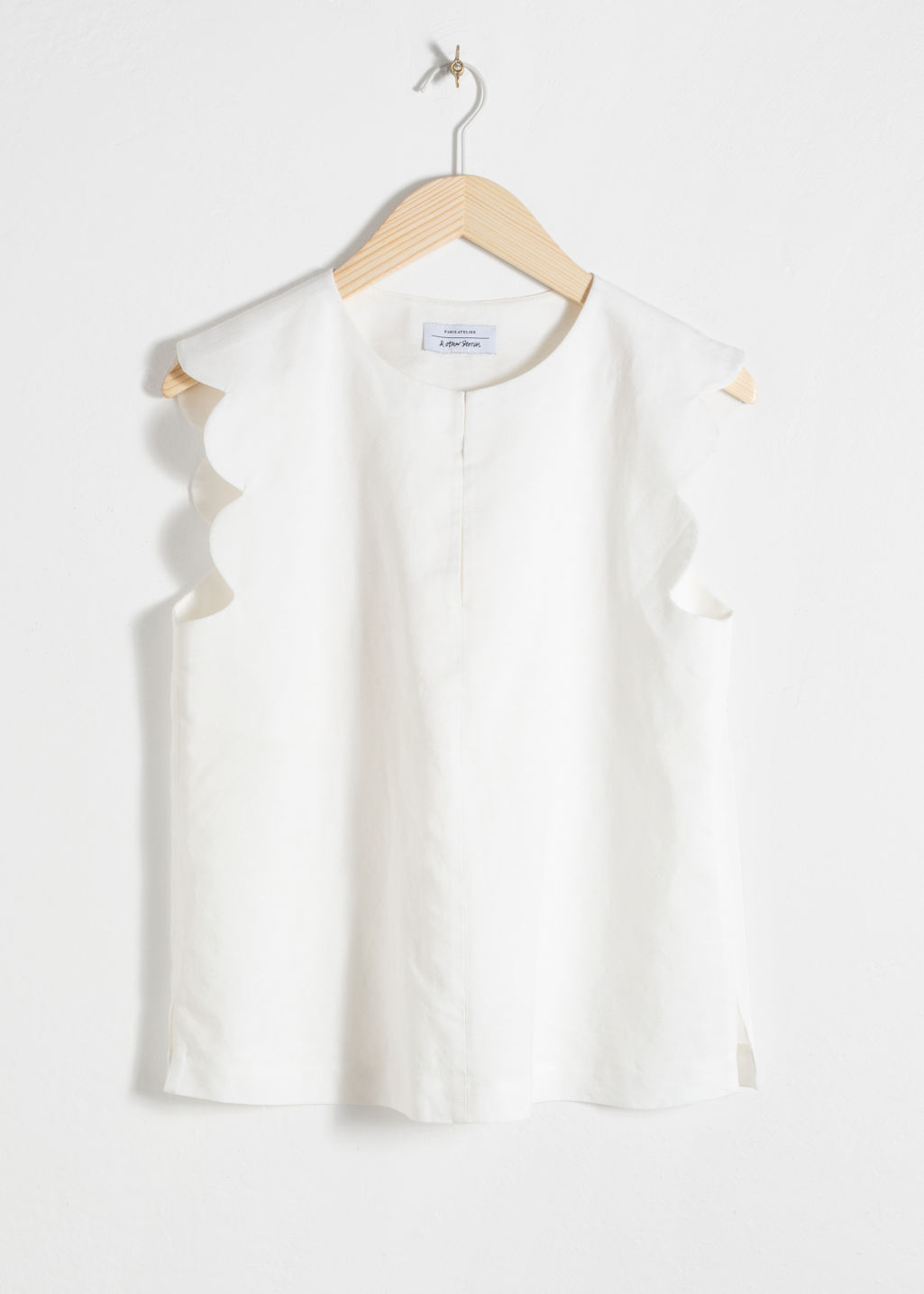Front image of Stories scalloped blouse in white