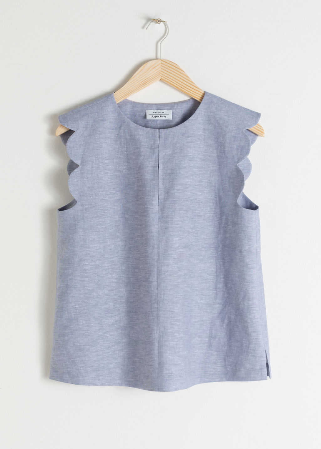 Front image of Stories scalloped blouse in blue