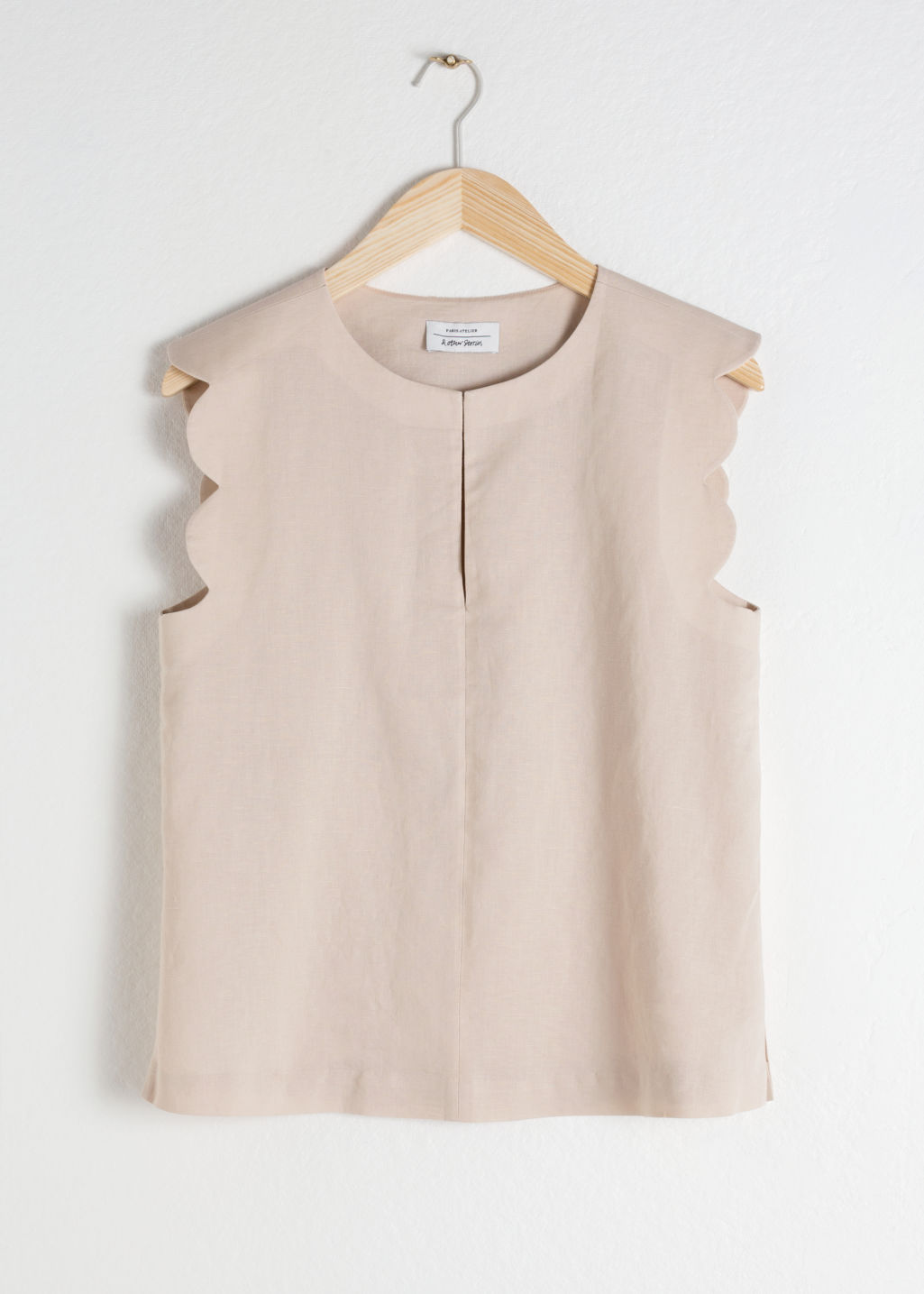 Front image of Stories scalloped blouse in beige