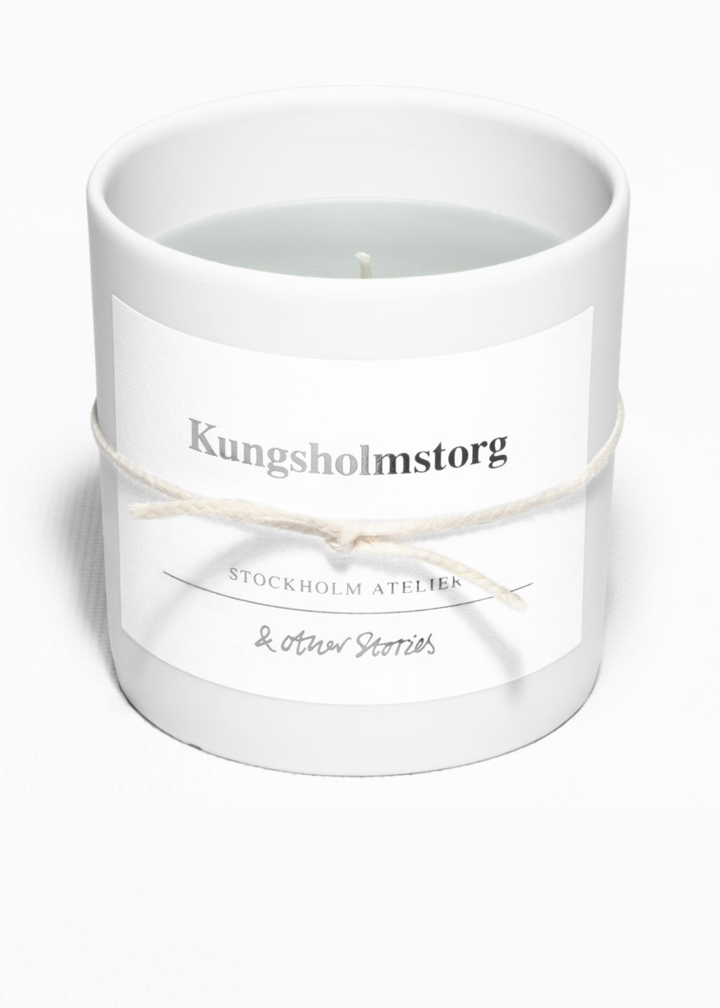 Front image of Stories scented candle in white