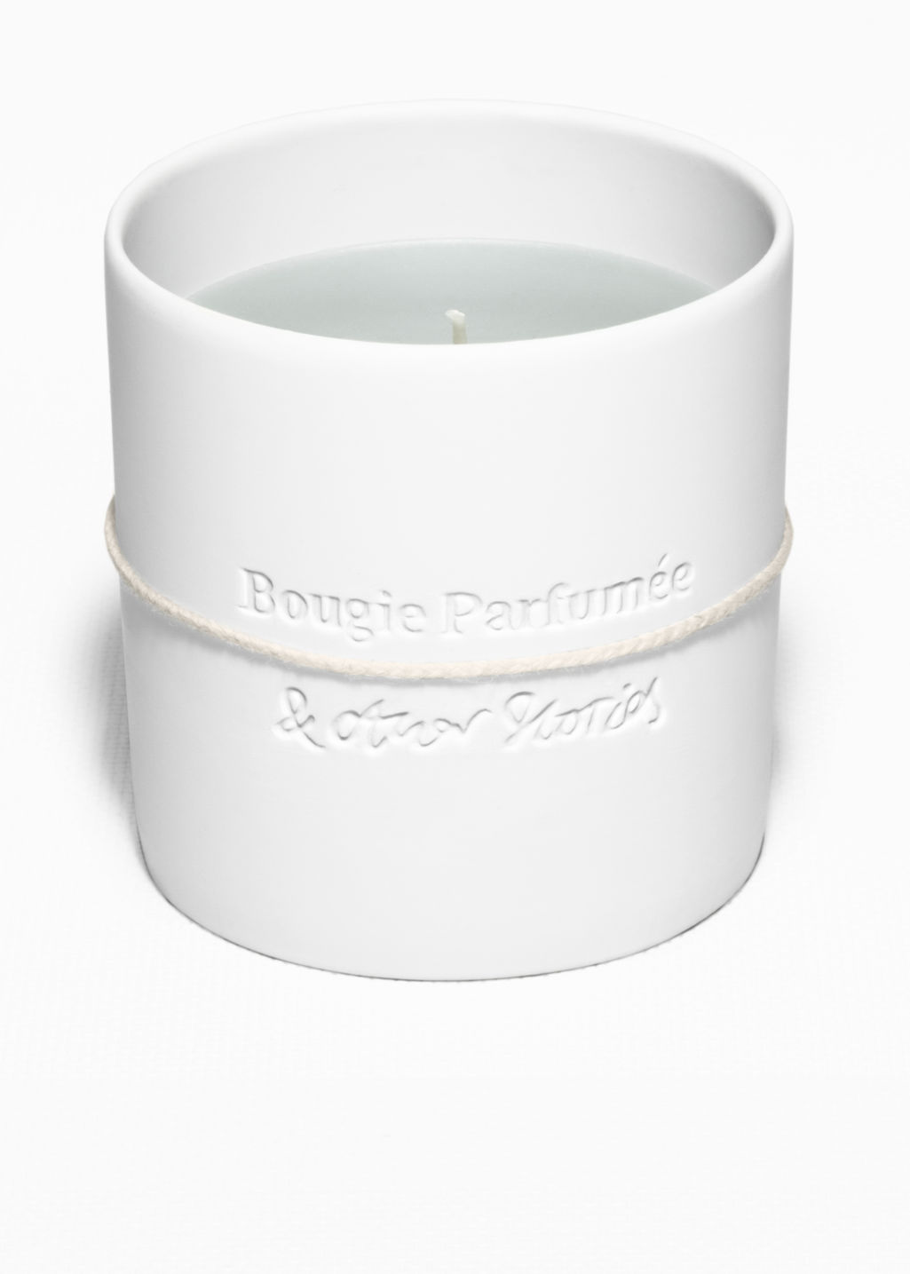 Back image of Stories scented candle in white