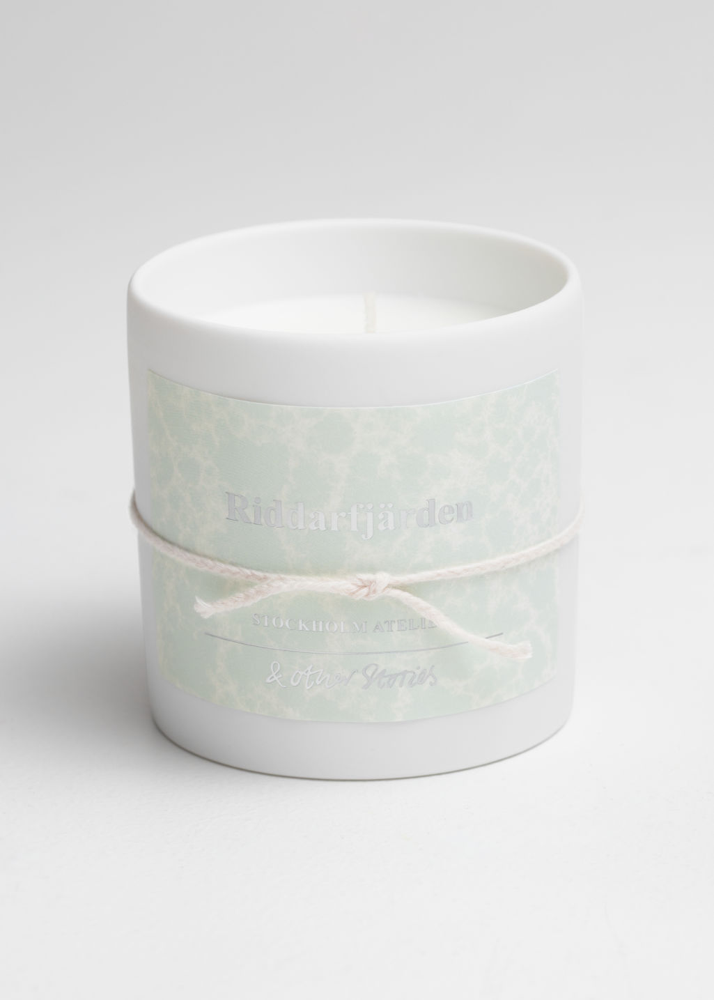 Front image of Stories scented candle in pink