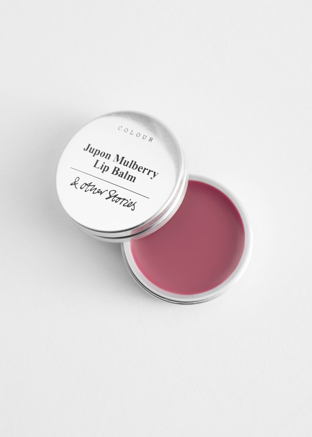 Front image of Stories lip balm in pink
