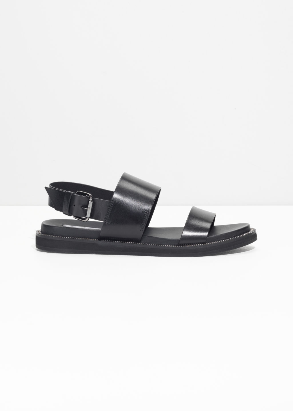 Front image of Stories raw edge leather sandals in black