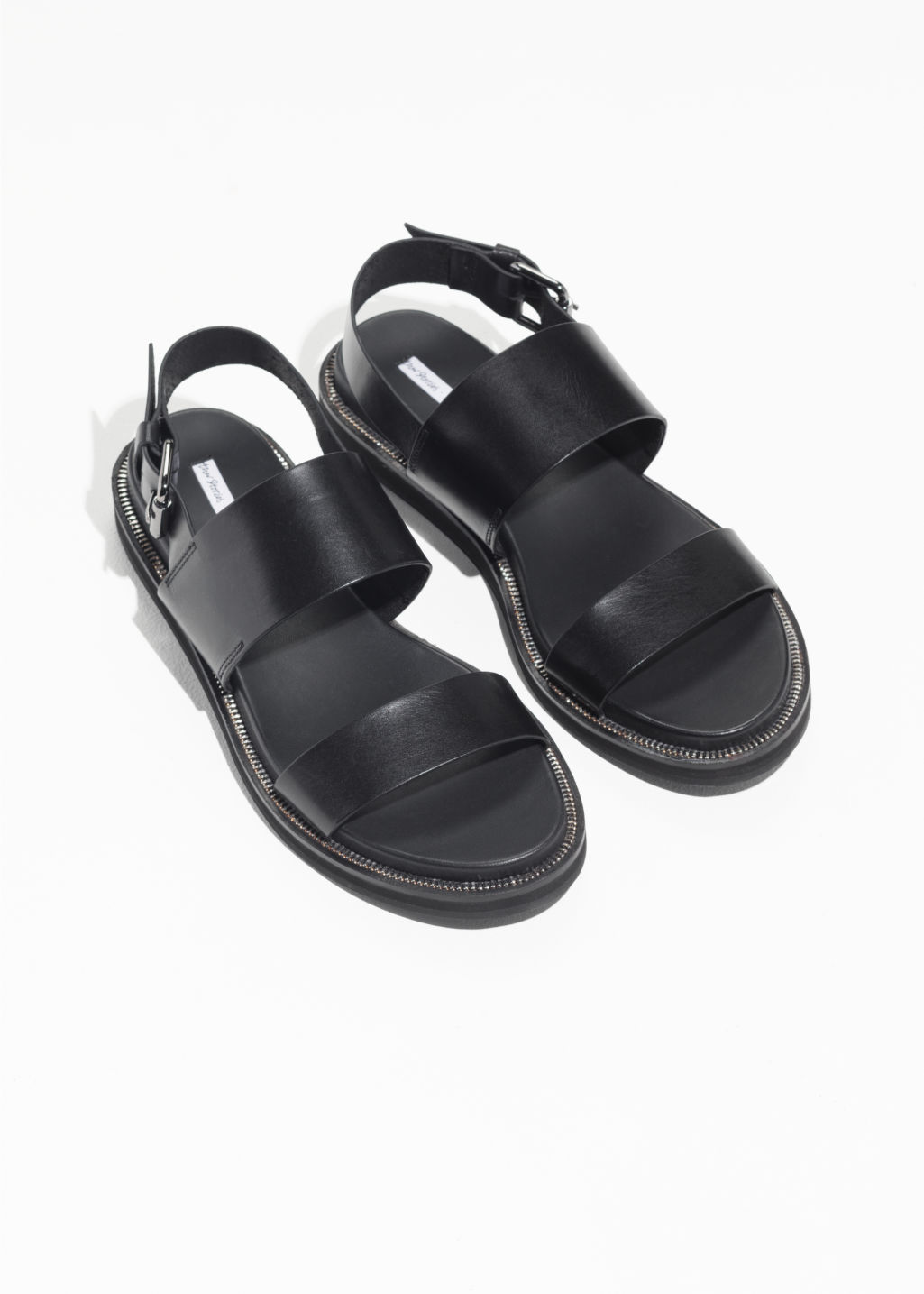 Back image of Stories raw edge leather sandals in black