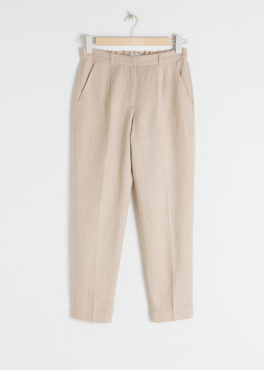 Front image of Stories tapered cotton trousers in beige