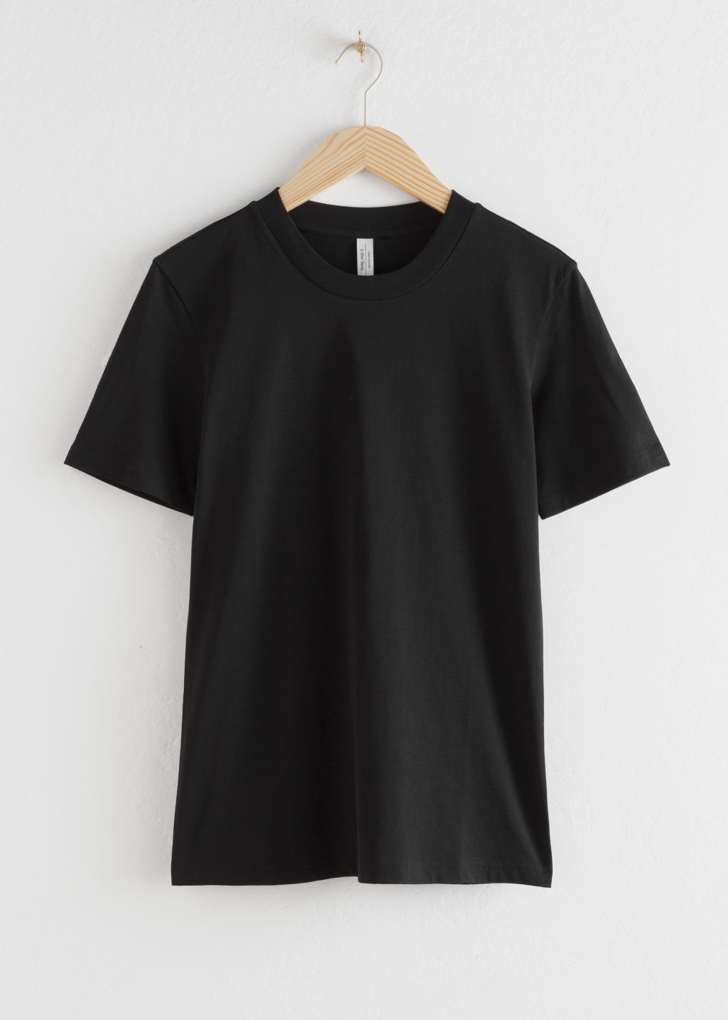 Front image of Stories cotton t-shirt in black