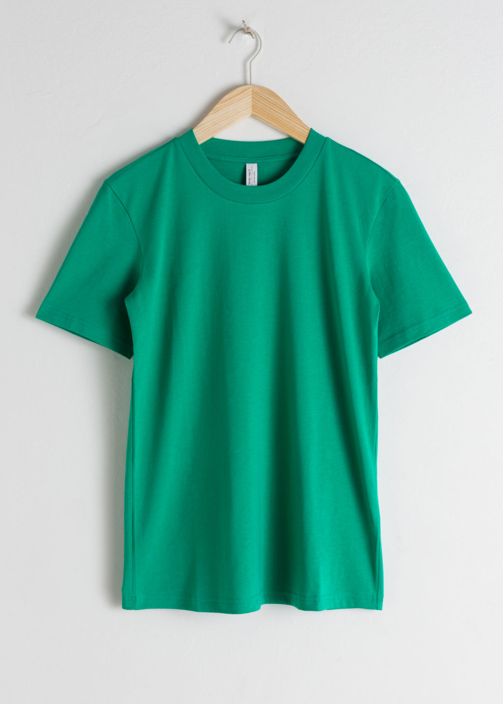 Front image of Stories cotton t-shirt in green