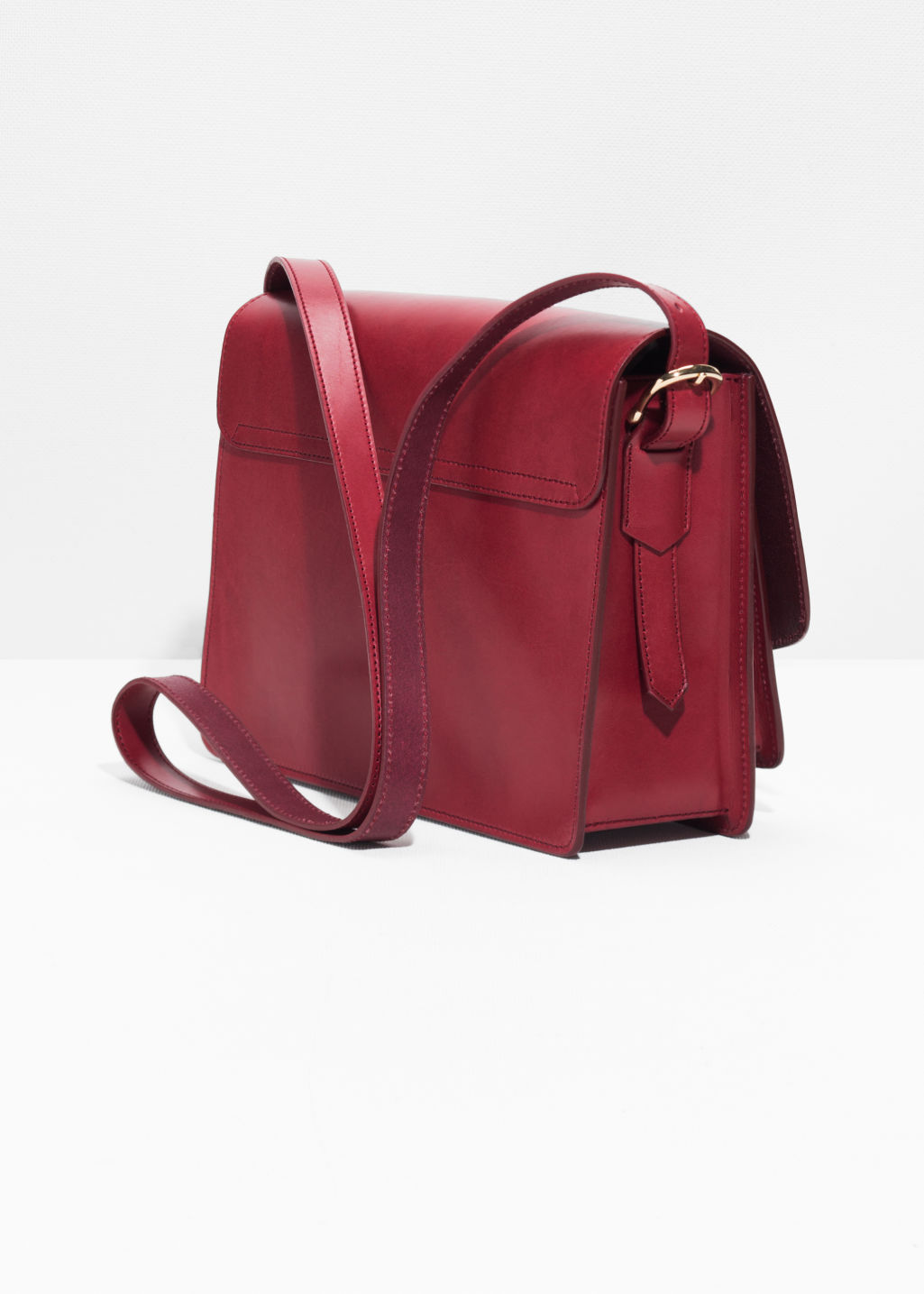 Back image of Stories saddle stitch leather shoulder bag in red