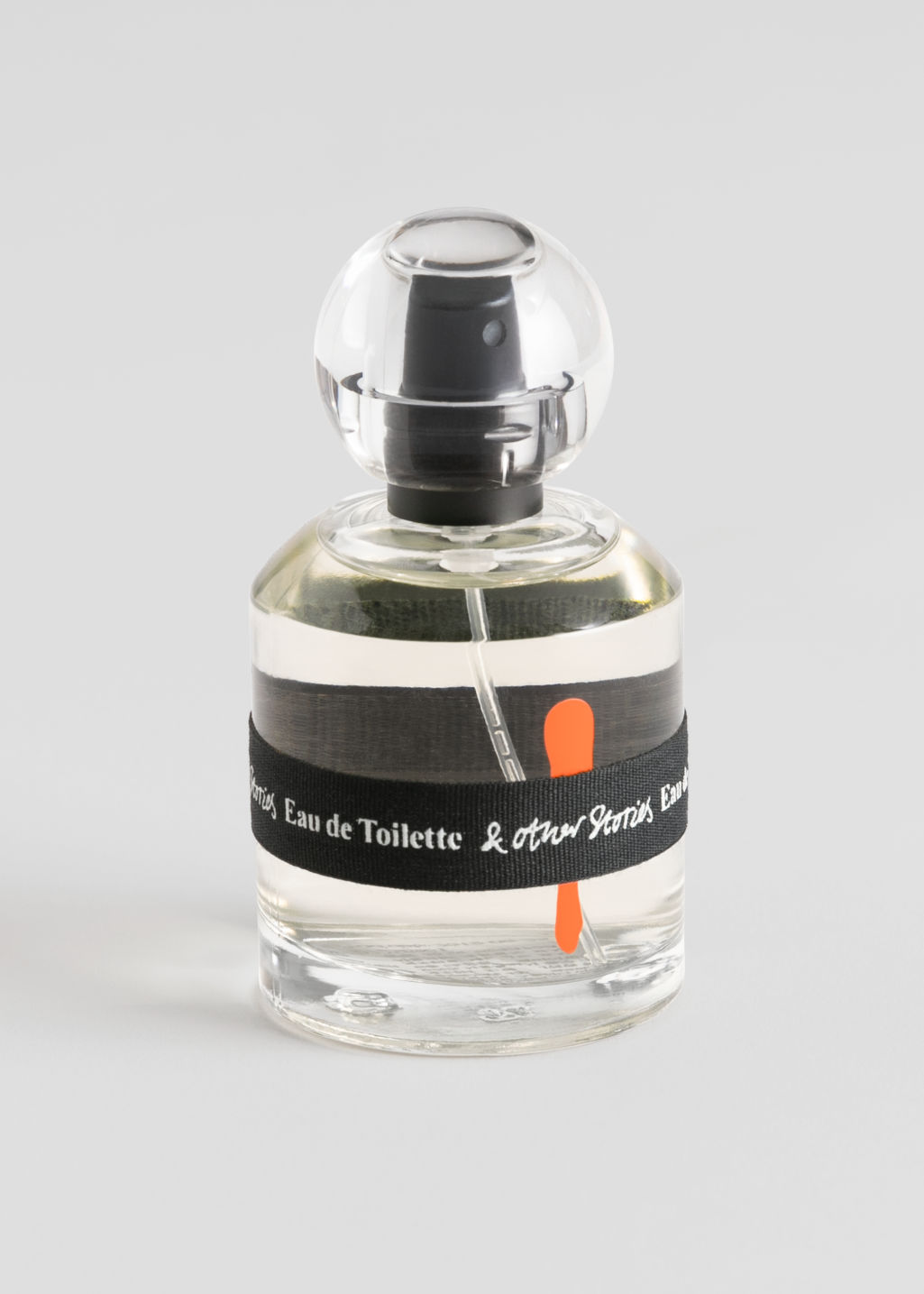 Front image of Stories eau de toilette in orange