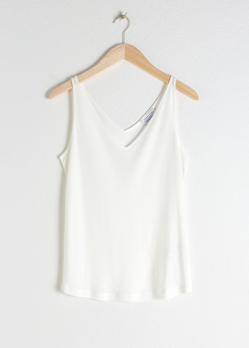 Front image of Stories ribbed v-neck top in white