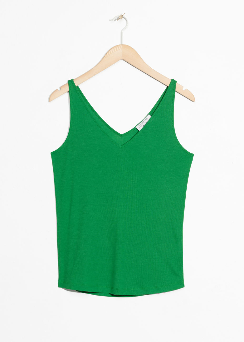Front image of Stories ribbed v-neck top in green