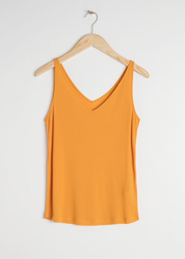 Front image of Stories ribbed v-neck top in yellow