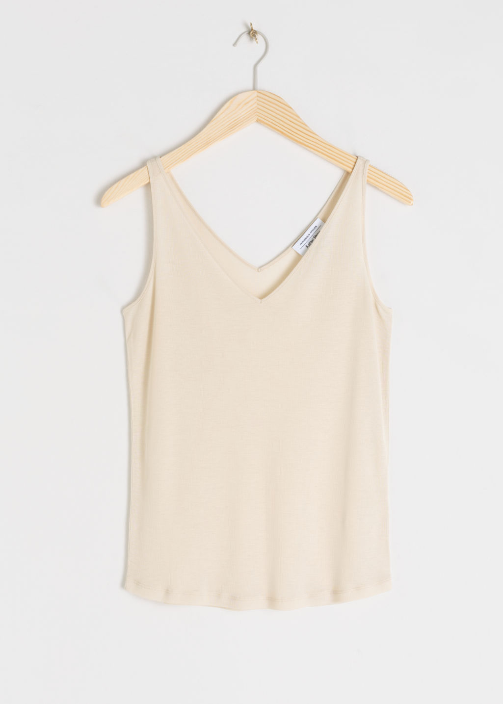 Front image of Stories ribbed v-neck top in beige