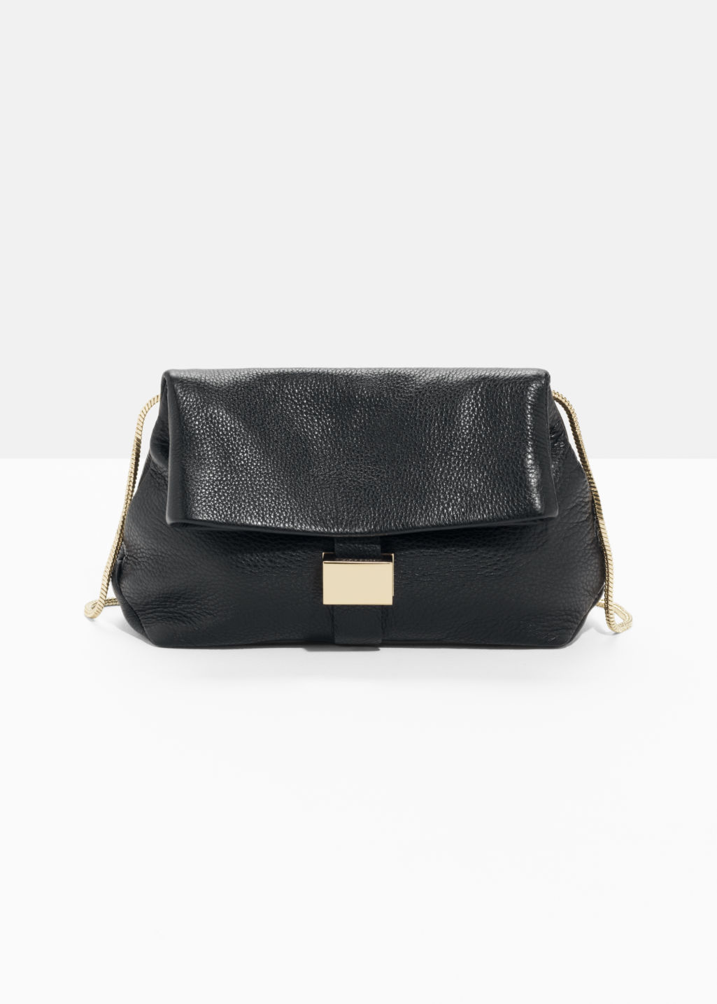 Front image of Stories small leather fold-over bag in black