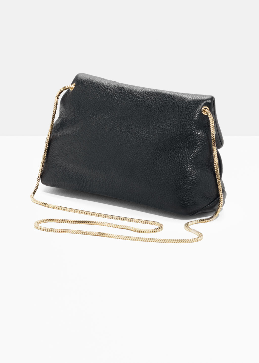 Back image of Stories small leather fold-over bag in black