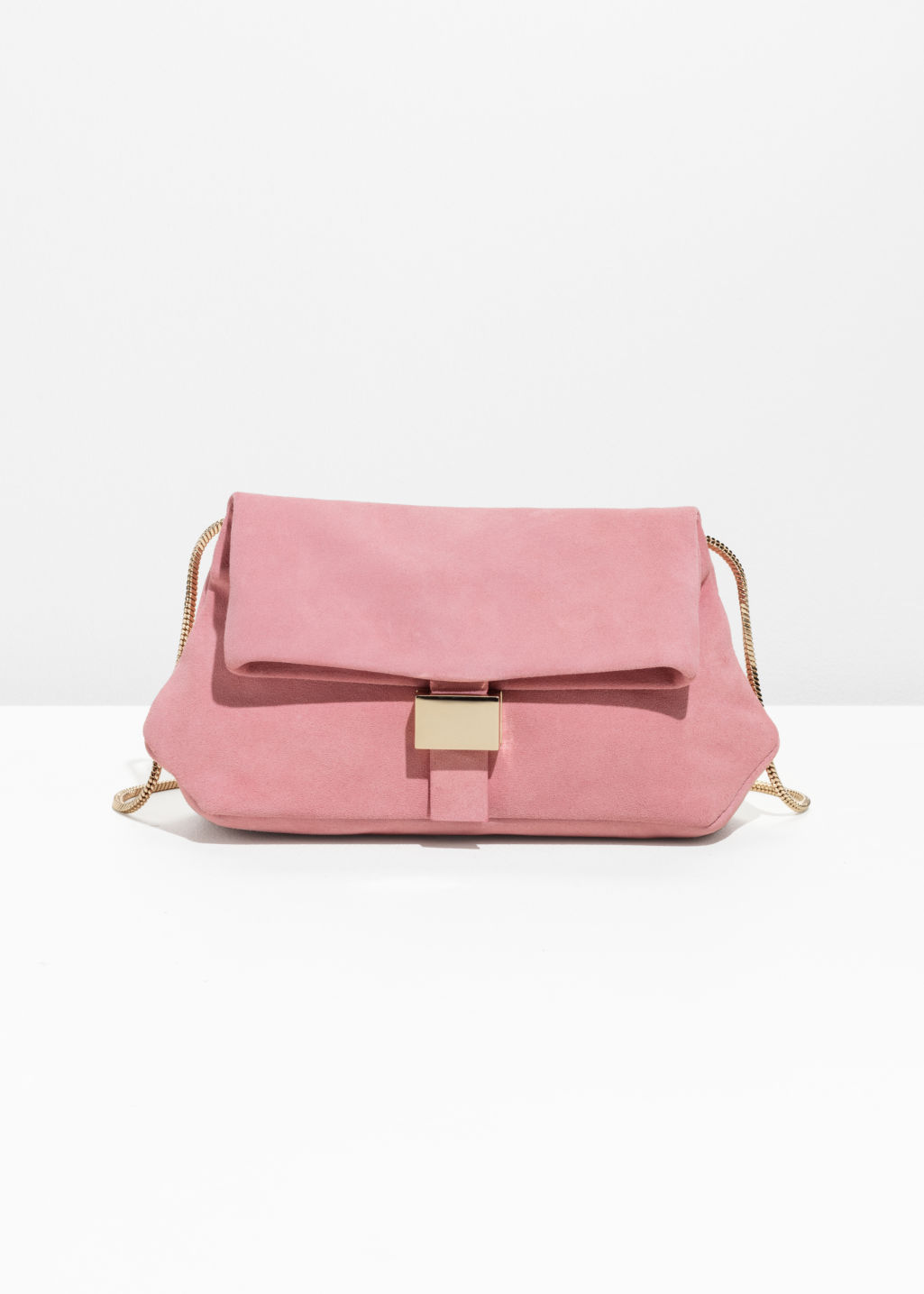 Front image of Stories small leather fold-over bag in pink
