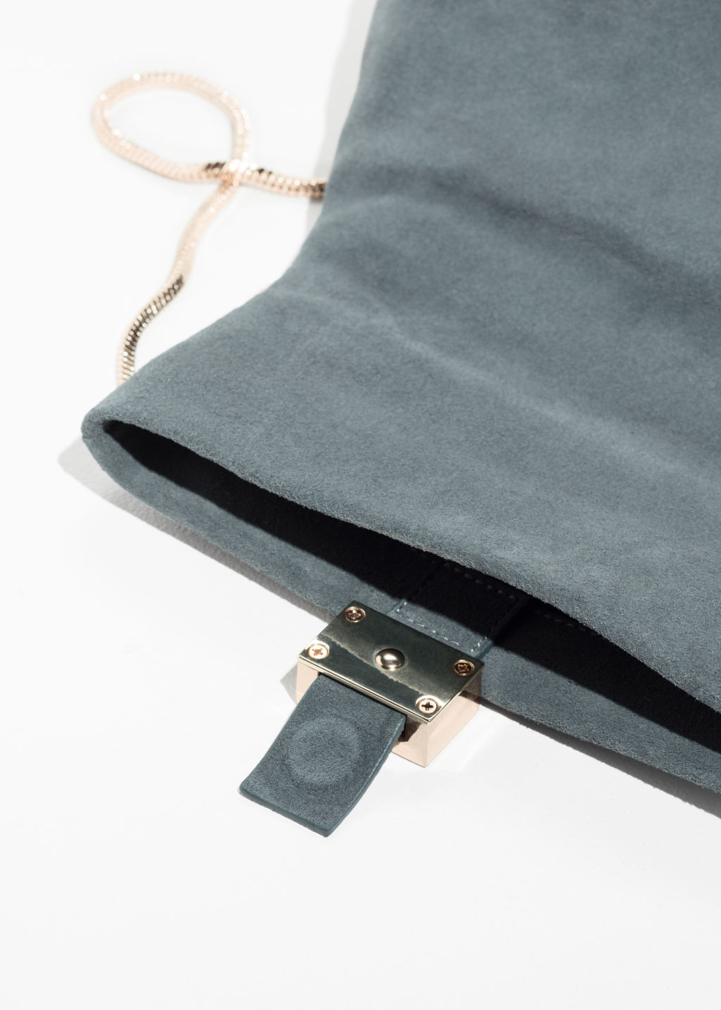 Back image of Stories small leather fold-over bag in blue