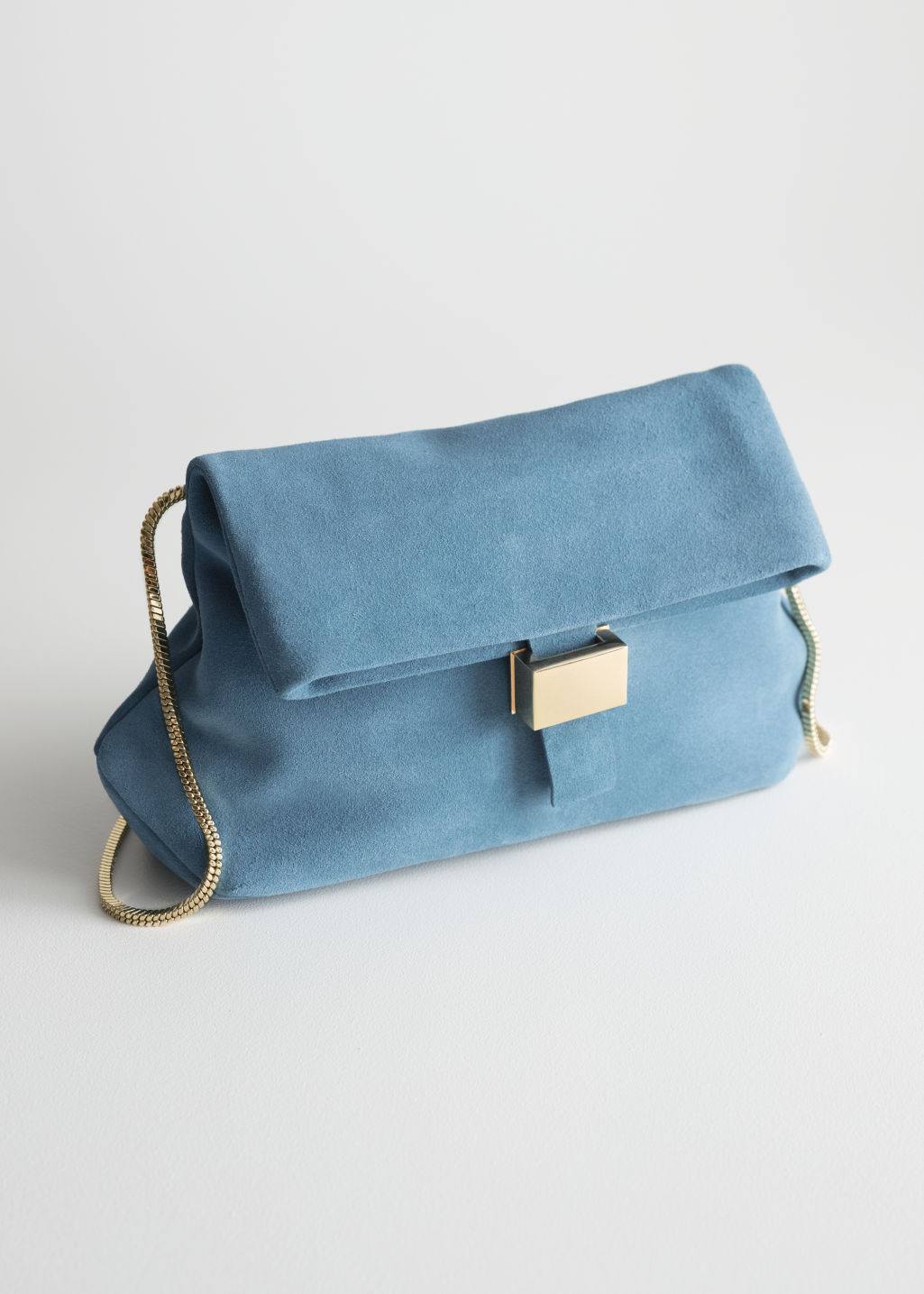 Front image of Stories small leather fold-over bag in blue