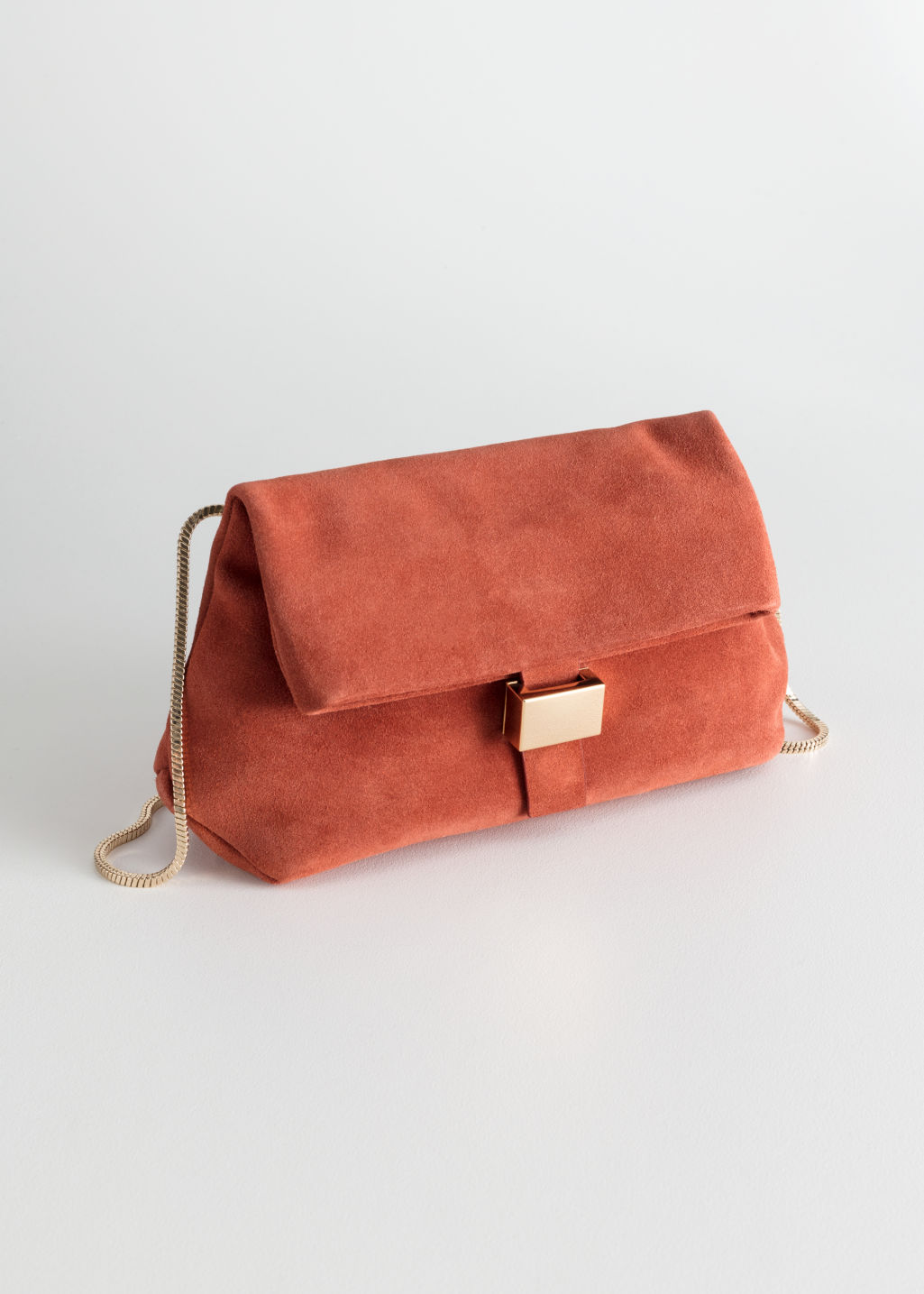 Front image of Stories small leather fold-over bag in red