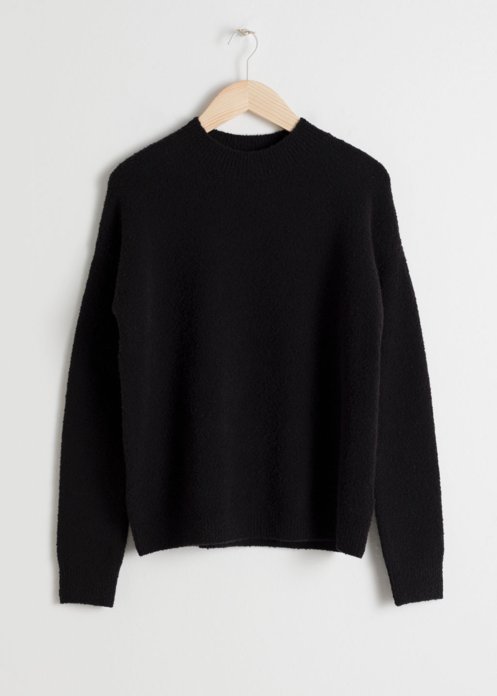 Front image of Stories knit sweater in black