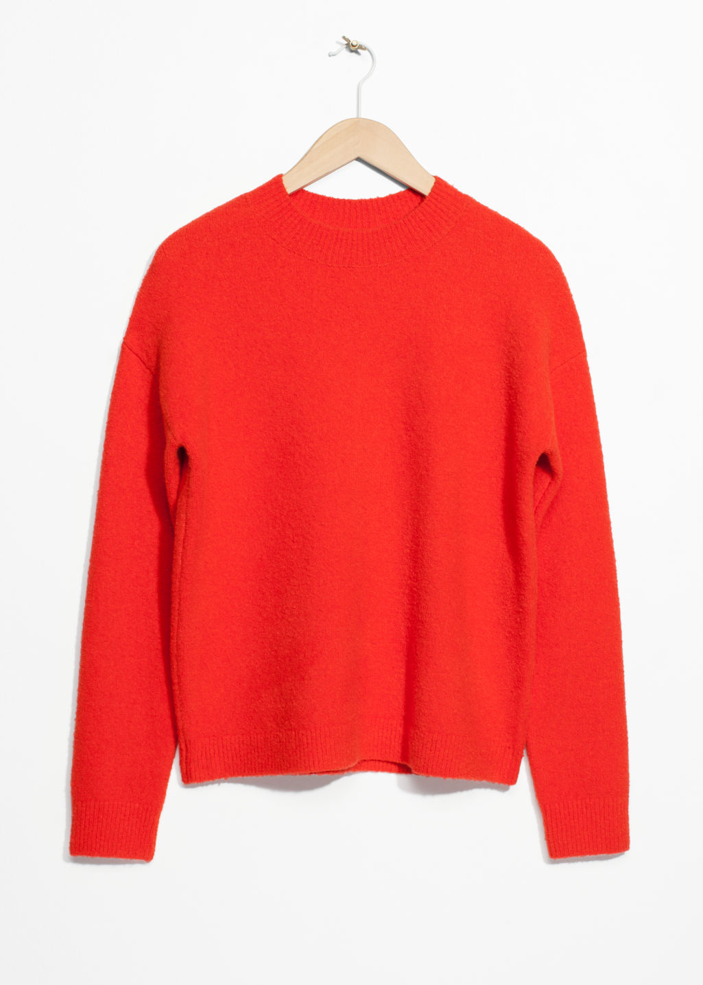 Front image of Stories knit sweater in orange