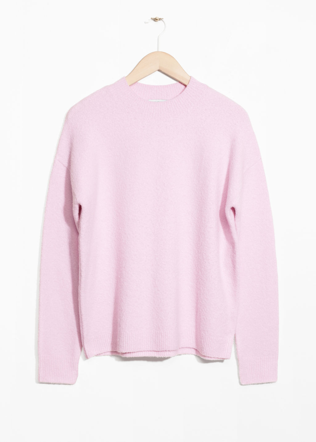 Front image of Stories knit sweater in pink