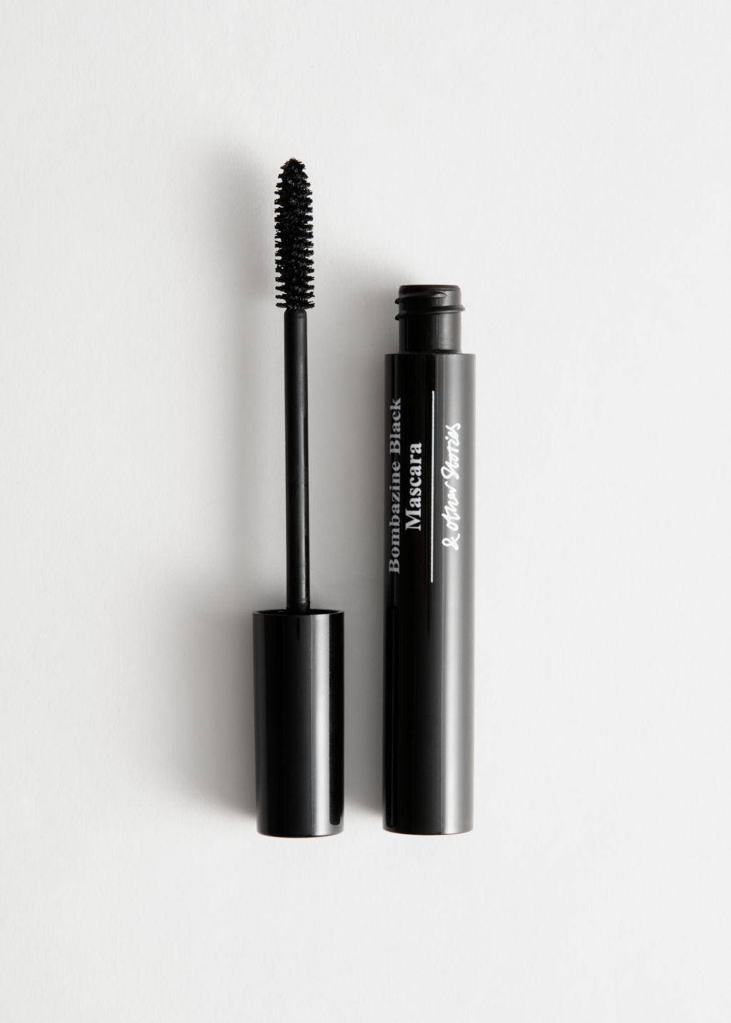 Front image of Stories volumising lengths mascara in black