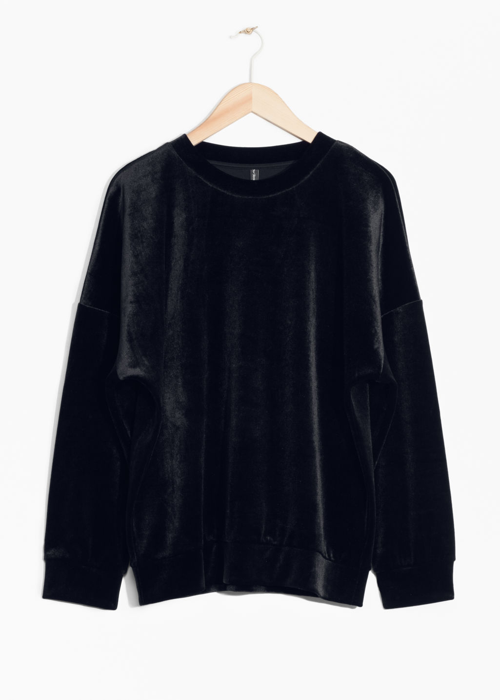 Front image of Stories velvet sweatshirt in black