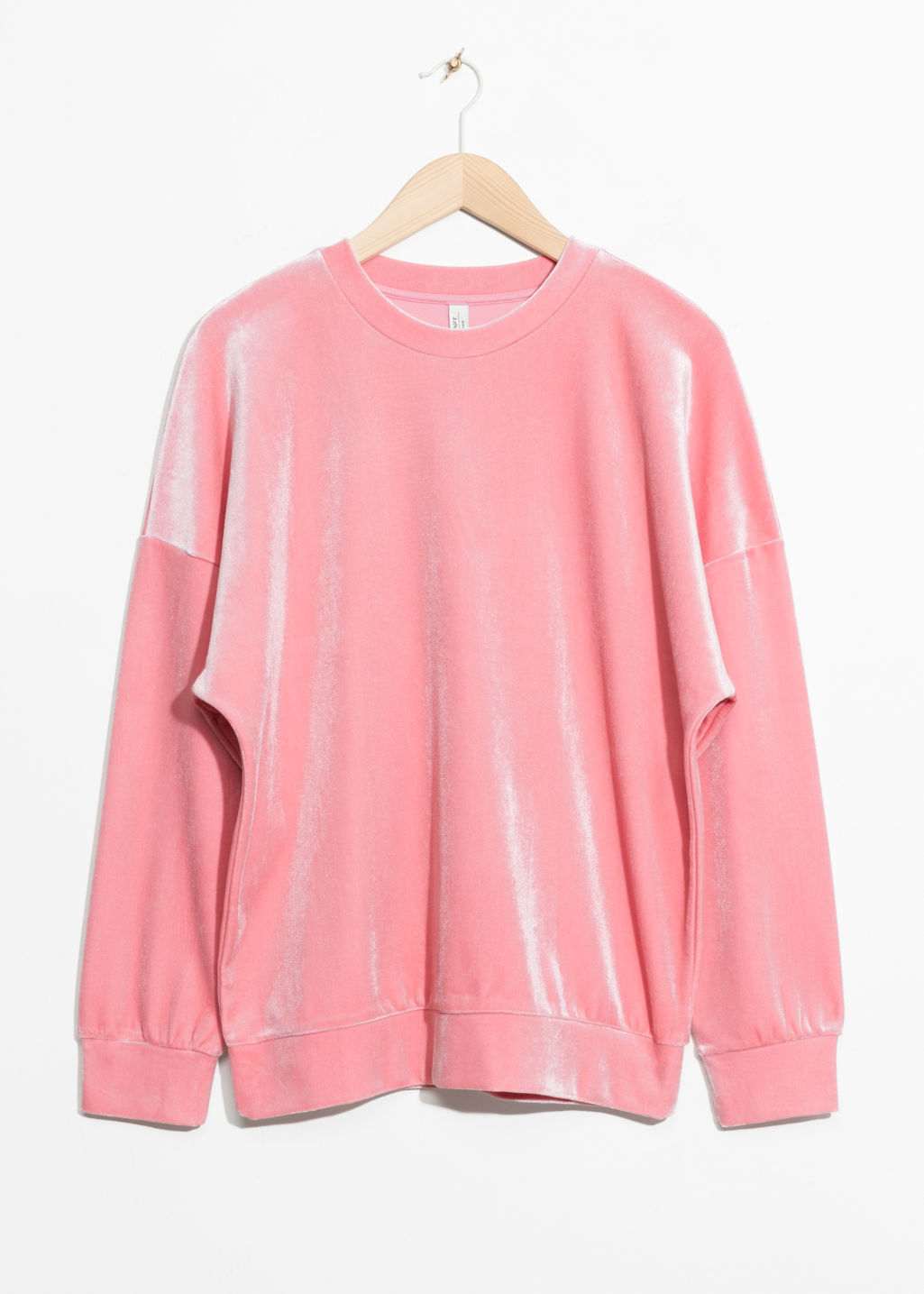Front image of Stories velvet sweatshirt in pink