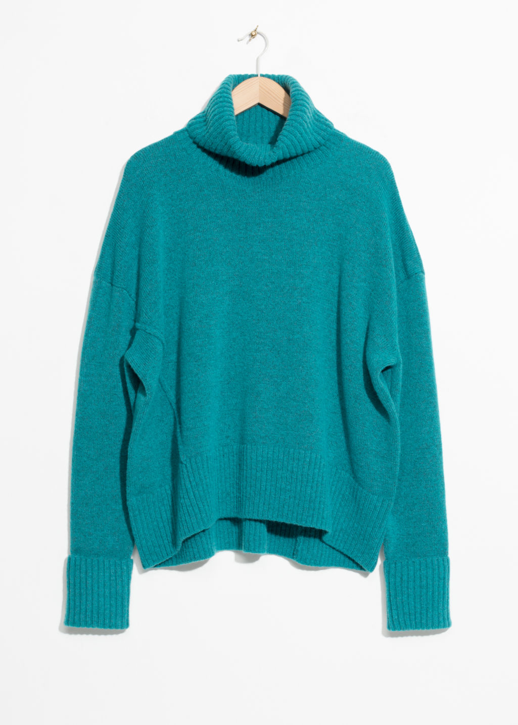 Front image of Stories turtleneck sweater in turquoise