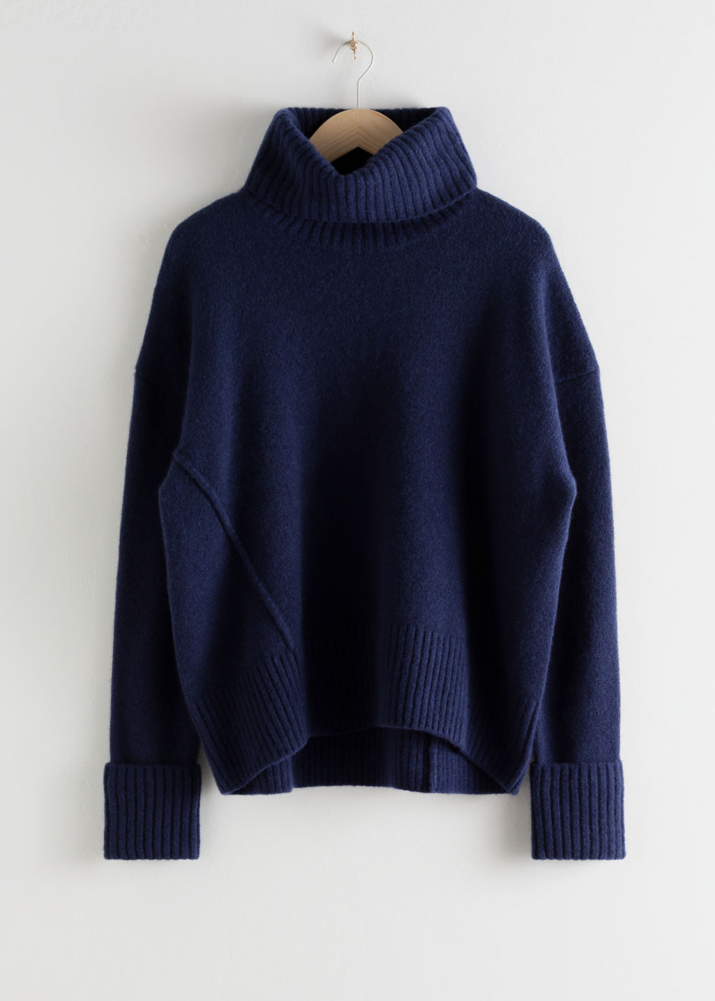 Front image of Stories wool blend turtleneck sweater in blue